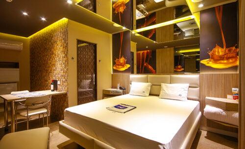 img-suite-luxo-nova-garagem-cama-golf-motel