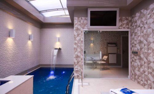 img-suite-piscina-premium-tv-externa-golf-motel